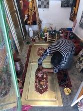 An artist painting a door in his studio. His paintings were so beautiful!